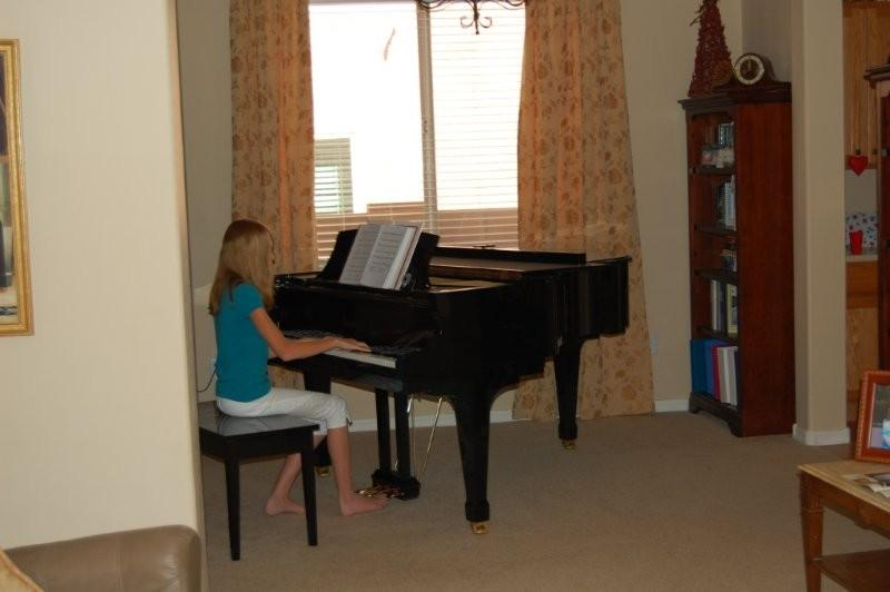 At the same moment, Paige was diligently practicing piano.